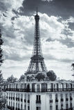 Eiffel Tower in Paris, France. Eiffel Tower and old buildings in Paris, France stock photo