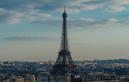 The Eiffel tower, Paris, France. The Eiffel tower and parisian houses.Millions of foreign visitors flocked to Paris helping the French capital to maintain its Stock Image