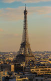 The Eiffel tower, Paris, France. The Eiffel tower and parisian houses.Millions of foreign visitors flocked to Paris helping the French capital to maintain its Royalty Free Stock Images