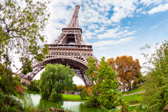 Eiffel Tower in Paris France and pond near. It over blue sky on Autumn day Stock Photography
