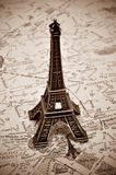The Eiffel Tower in Paris, France. A reproduction of the Eiffel Tower on a map of Paris, with sepia toning Royalty Free Stock Photos
