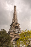 Eiffel Tower in Paris, France under a cloudy sky Stock Images