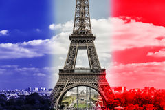 The Eiffel tower in Paris. The Eiffel tower on French flag background in Paris Stock Image