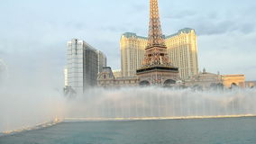 Eiffel Tower of Paris Hotel, Fountains of Bellagio, Las Vegas,. LAS VEGAS, USA - APR 04: Fountains of Bellagio with Eiffel Tower of Paris Hotel background on