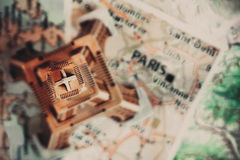 Eiffel Tower on the Paris map. Travel background Stock Photography