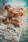 Eiffel Tower on the Paris map. Travel background Stock Image