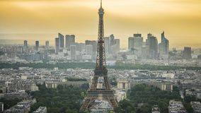 Eiffel Tower in Paris, modern business centers at back, urban life time-lapse. Stock footage stock footage