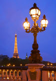The Eiffel Tower in Paris at night. With lamp post in foreground Stock Photo