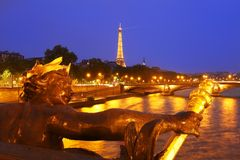 The Eiffel Tower in Paris at night Stock Photos