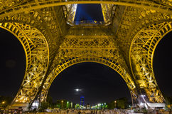Eiffel Tower in Paris by night. The Eiffel Tower is an iron lattice tower located on the Champ de Mars in Paris, France. It was named after the engineer Stock Photo