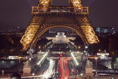 Eiffel Tower in Paris at night with lights on royalty free stock images