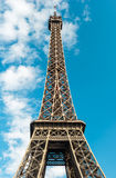 Eiffel Tower in Paris over cloudy blue sky Royalty Free Stock Photography