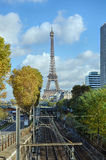 Eiffel Tower in Paris and the railway on a sunny day Royalty Free Stock Photos