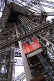 Eiffel tower Paris, red elevator. View of the red lift of the Eiffel tower of Paris stock photos