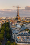 Eiffel Tower and Paris rooftops before sunset, France Stock Images