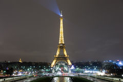 Eiffel Tower and Paris Skyline. At night from Trocadero Park with beams of light shining from high on the tower Royalty Free Stock Photography