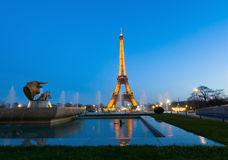 Eiffel tower paris and statue of bull head Stock Photos