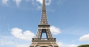 Eiffel Tower in Paris in a sunny day, frontal tilt view, blue sky in France