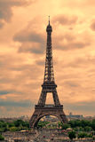 Eiffel Tower in Paris at sunset with cumulus clouds. Stock Photos