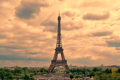 Eiffel Tower in Paris at sunset with cumulus clouds. royalty free stock photos