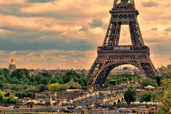 Eiffel Tower in Paris at sunset with cumulus clouds. Royalty Free Stock Images