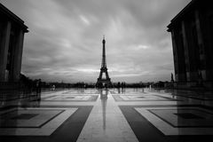 Eiffel tower, Paris symbol and iconic landmark in France, on a cloudy day. Dusk city. Famous touristic place and Stock Photos