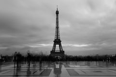 Eiffel tower, Paris symbol and iconic landmark in France, on a cloudy day. Dusk city. Famous touristic place and Royalty Free Stock Photos