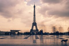 Eiffel tower, Paris symbol and iconic landmark in France, on a cloudy day. Famous touristic places and romantic travel. Destinations in Europe. Cityscape and Stock Photo