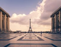 Eiffel tower, Paris symbol and iconic landmark in France, on a cloudy day. Famous touristic places and romantic travel. Destinations in Europe. Cityscape and Royalty Free Stock Photos