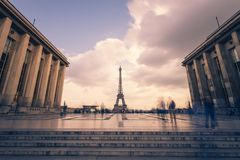 Eiffel tower, Paris symbol and iconic landmark in France, on a cloudy day. Famous touristic places and romantic travel. Destinations in Europe. Cityscape and Royalty Free Stock Images