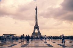Eiffel tower, Paris symbol and iconic landmark in France, on a cloudy day. Famous touristic places and romantic travel. Destinations in Europe. Cityscape and Royalty Free Stock Image