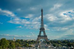 Eiffel tower, Paris symbol and iconic landmark in France, on a sunny day with clouds in the sky. Famous touristic places Stock Photo