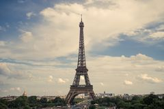 Eiffel tower, Paris symbol and iconic landmark in France, on a sunny day with clouds in the sky. Famous touristic places. And romantic travel destinations in Stock Photos