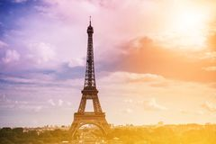 Eiffel tower, Paris symbol and iconic landmark in France, on a sunny day with sunbeams in the sky. Famous touristic Stock Images