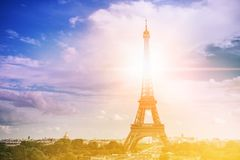 Eiffel tower, Paris symbol and iconic landmark in France, on a sunny day with sunbeams in the sky. Famous touristic Royalty Free Stock Images