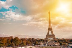 Eiffel tower, Paris symbol and iconic landmark in France, on a sunny day with sunbeams in the sky. Famous touristic. Places and romantic travel destinations in Stock Photography