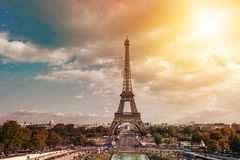 Eiffel tower, Paris symbol and iconic landmark in France, on a sunny day with sunbeams in the sky. Famous touristic. Places and romantic travel destinations in Royalty Free Stock Photo