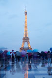 Eiffel tower in Paris with tourists at dusk Stock Photo