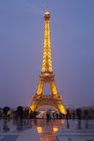 Eiffel tower in Paris with tourists at dusk Royalty Free Stock Photography