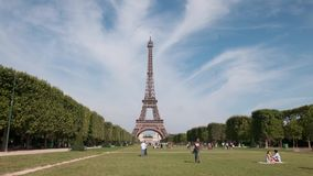 Eiffel tower in Paris. A view of Eiffel Eiffel tower in Paris from champ de Mars. Timelapse stock video footage