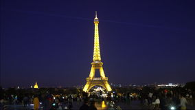 Eiffel tower in Paris. A view of the light in the Eiffel tower by night in Paris stock footage