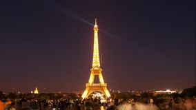 Eiffel tower in Paris. A view of Eiffel Eiffel tower in Paris by night. Timelapse stock footage