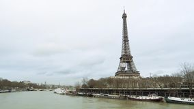 Eiffel Tower and overflowing Seine River Paris flooding. Eiffel Tower in Paris view from still drone on the middle of the Seine River during floods overflowing stock video