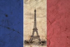 Eiffel Tower in Paris. Vintage view background. Tour Eiffel old retro style photo with cracks crumpled paper. Royalty Free Stock Image