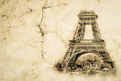 Eiffel Tower in Paris. Vintage view background. Tour Eiffel old retro style photo with cracks crumpled paper. Stock Photo