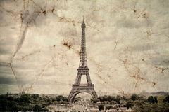 Eiffel Tower in Paris. Vintage view background. Tour Eiffel old retro style photo with cracks crumpled paper. Stock Image