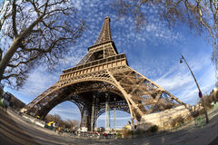 Eiffel Tower in Paris on the winter with the white clouds. France royalty free stock photography