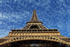 Eiffel Tower in Paris on the winter with the white clouds. France stock photo