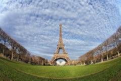 Eiffel Tower in Paris on the winter with the white clouds. France royalty free stock images