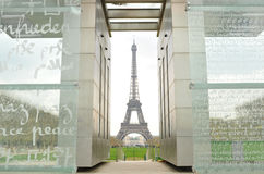 Eiffel Tower and Peace Monument. Perspective of Eiffel Tower seen through the Peace Monument in Paris Royalty Free Stock Photos